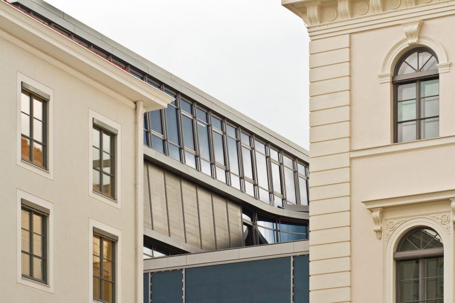 A part of Siemens' building as seen from th angle in between two more classical buildings.