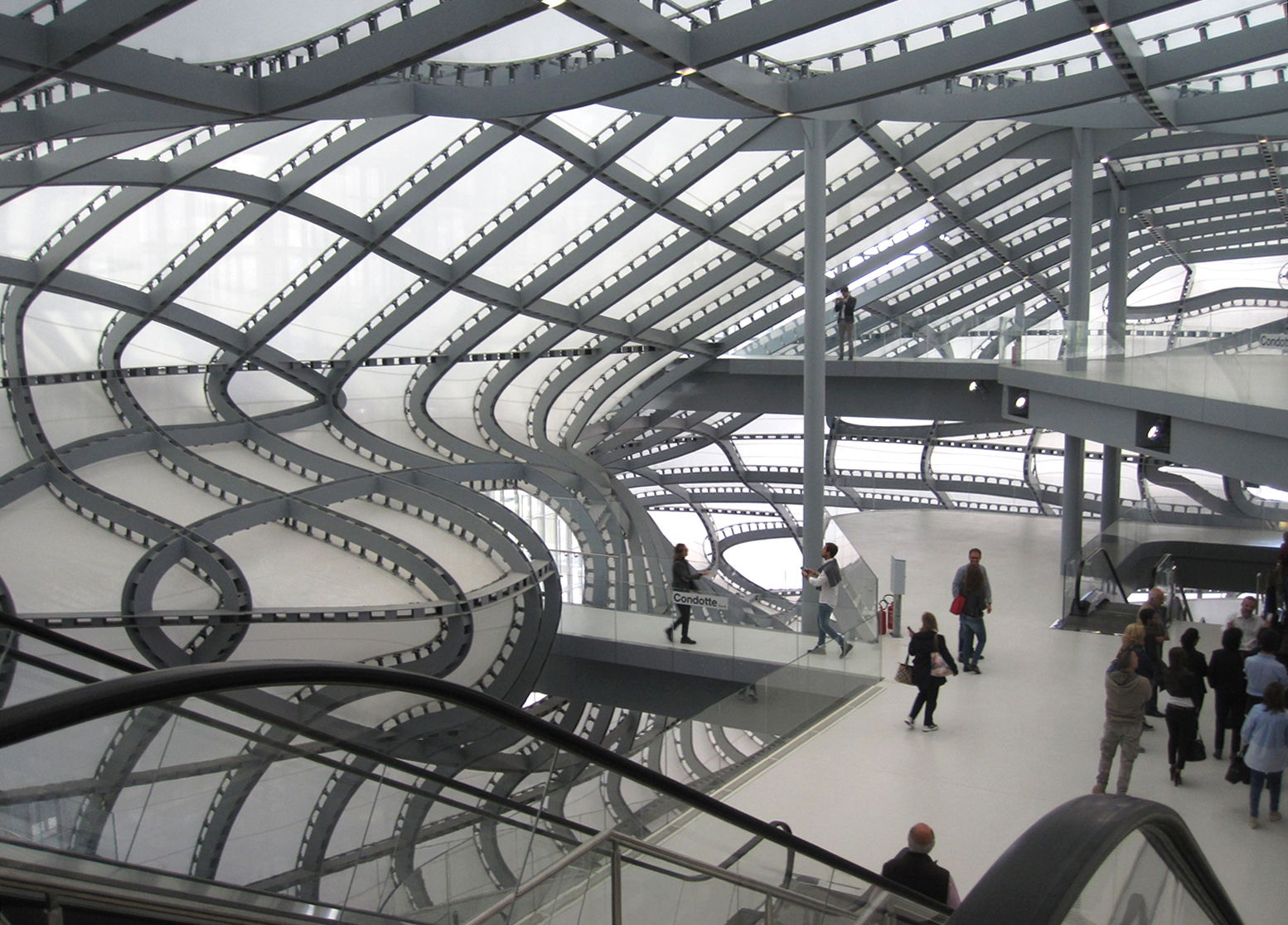 The curvilinear indoors of the new hotel and congress center in Rome's EUR district