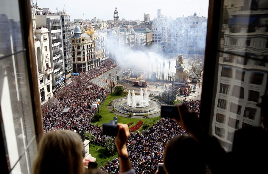 From a high window, a view over Plaza Ayuntamiento square, where the crowd takes part in the celebration of Las Fallas