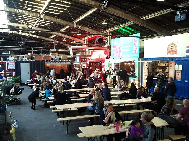 The former shipping containers on the back are now working as kitchens in the Aarhus Street Food area.