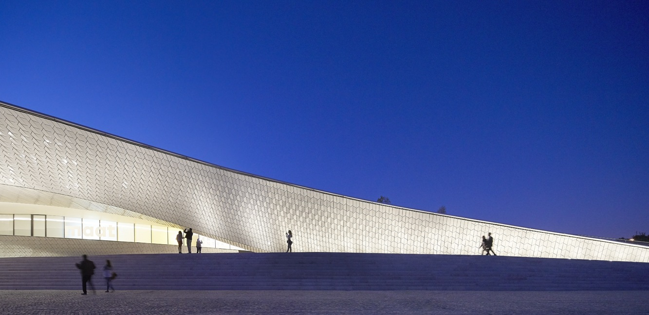 A nocturnal perspective on part of the 15.000 glazed tiles that cover MAAT, in Lisbon.