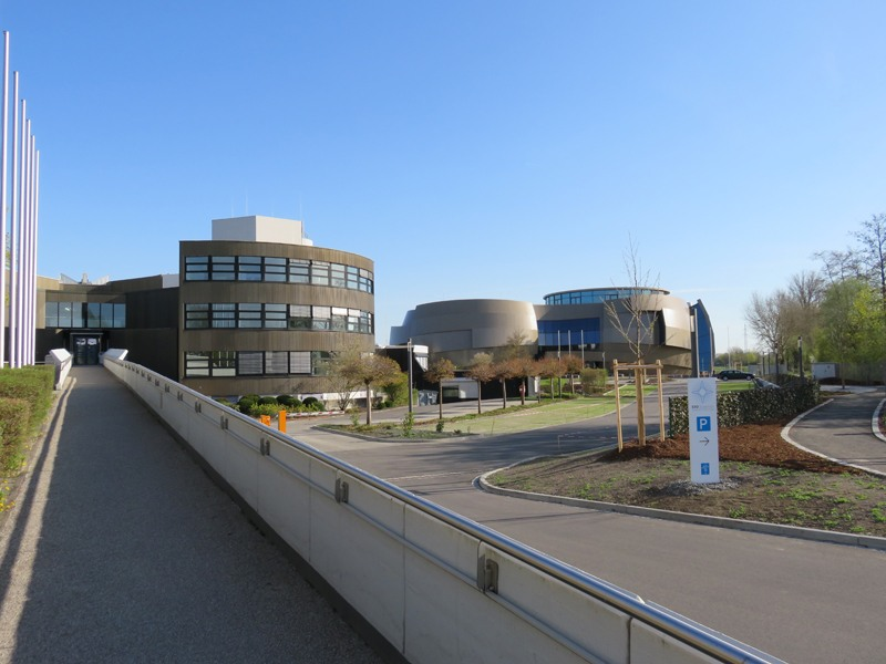 View of the main entrance of ESO Headquarters with ESO Supernova next to it. Copyright: Claudia Neeser.