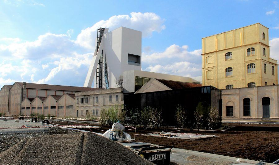 Torre and the Haunted House seen from the new public garden - Fondazione Prada by OMA. Copyright: Carlo Berizzi.
