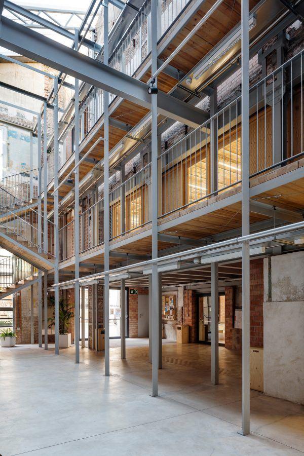 Lleialtat Santsenca by HARQUITECTES – The building`s main circulation element resembles the scaffolding of a building under construction. Copyright: Adrià Goula.