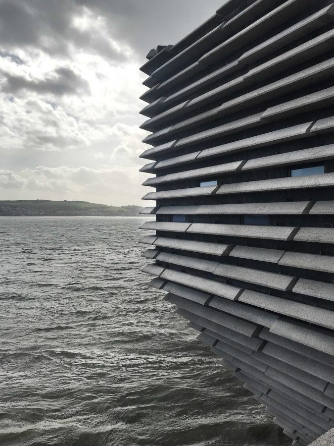 The façade of the V&A Dundee as it meets the River Tay in Dundee. Photo by: ©Dress for the Weather