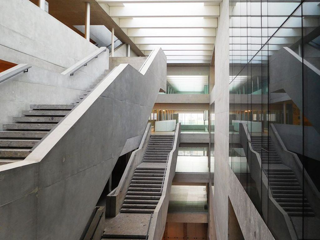 Staircases and terraces at different levels carve the inner space. Grafton Architects, Bocconi University, Milan. Photo by ©Carlo Berizzi